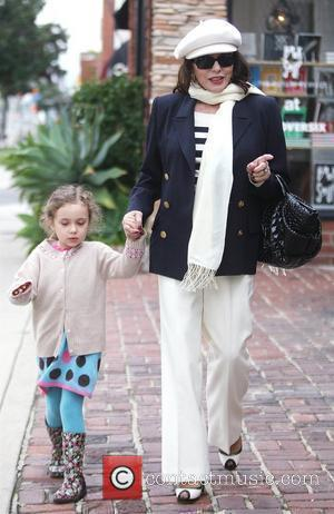 Joan Collins leaving Lloyd Klein Couture in West Hollywood with her 6-year-old granddaughter, Ava Grace Newley Los Angeles, California -...