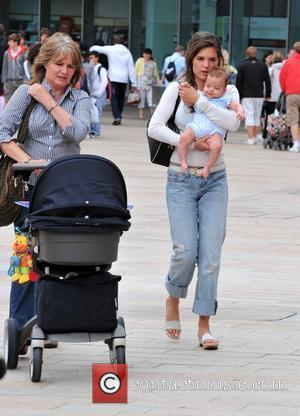 Carly Zucker, with her daughter Ruby Cole, out shopping following her footballer husband's move to Liverpool FC Liverpool, England -...