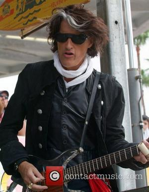 Guitarist Joe Perry  rehearses on stage prior to the start of the at Miami Dolphins game at Landshark Stadium...