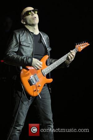 Joe Satriani  performing live on stage at Massey Hall.  Toronto, Canada - 08.12.10