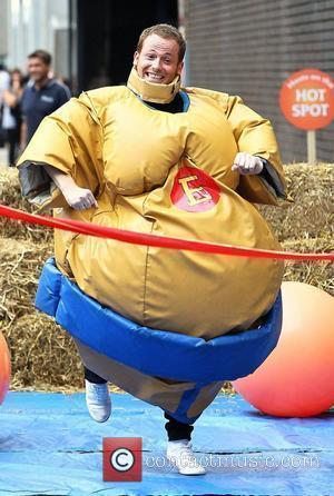 Joe Swash  wearing a Sumo-wrestler costume while filming 'This Morning'  London, England - 19.07.10