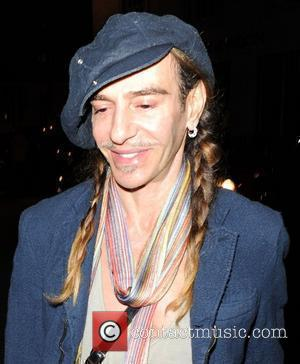 Fashion Designer and John Galliano