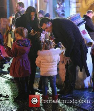 John Terry, Toni Terry and their children enjoy hot dogs, while visiting 'Winter Wonderland' in Hyde Park. London, England -...