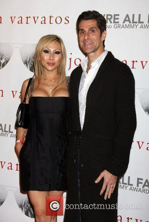 Perry Farrell & wife Etty Lau Farrell John Varvatos' 52nd Annual Grammy Awards 'We're All Fans' party in West Hollywood...