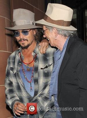 Johnny Depp and Keith Richards both wearing fedora hats and sunglasses, leaving 'C London' restaurant. Depp was sporting some cuts...