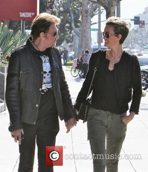 Johnny Hallyday and his wife Laetitia Boudou seen leaving Simoni Plastic Surgery building on La Cienega Los Angeles, California -...