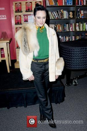 Johnny Weir American figure skater signing copies of his new book 'Welcome to My World' at Borders New York City,...