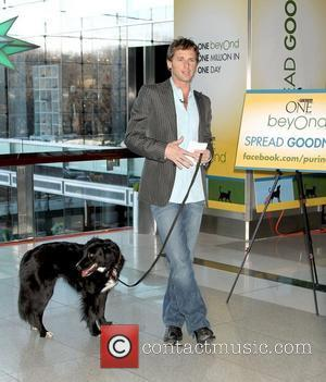 Josh Lucas with his dog Loki helps Purina donate $1million in one day to charity during the Purina ONE Beyond...