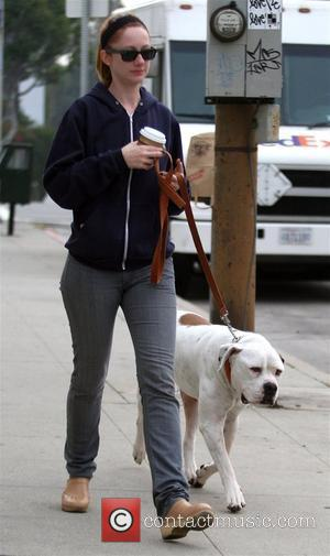 Judy Greer drinking coffee while out walking her dog in West Hollywood. Los Angeles, California - 02.02.10
