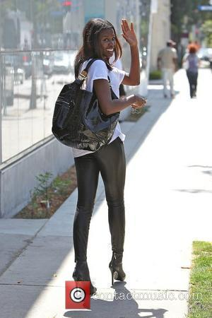 English television presenter June Sarpong, wearing leather leggings, out and about in West Hollywood Los Angeles, California - 16.06.10