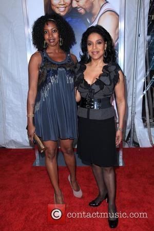 Actress Phylicia Rashad and guest The premiere of 'Just Wright' held at the Ziegfeld Theater. New York City, USA -...