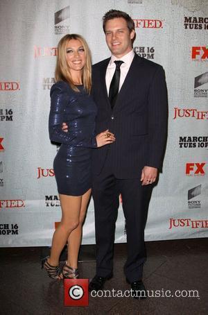 Natalie Zea and Travis Schuldt FX's Justified - Los Angeles Premiere Screening Held At Directors Guild Theatre West Hollywood, California...