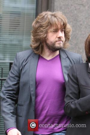 Justin Lee Collins wearing a tight purple t-shirt while leaving the BBC Radio One studios London, England - 22.03.10