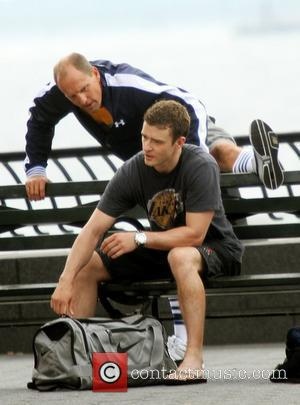 Woody Harrelson and Justin Timberlake change clothes to play basketball on the set of the new film 'Friends with Benefits'...