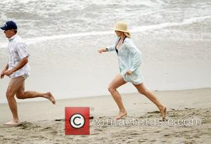 Jenna Elfman and Richard Jenkins filming 'Friends with Benefits' on location at a beach Los Angeles, California - 07.09.10