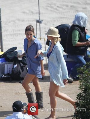 Mila Kunis and Jenna Elfman filming 'Friends with Benefits' on location at a beach Los Angeles, California - 07.09.10