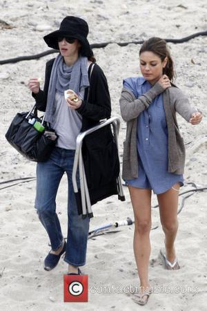 Mila Kunis and cast member filming 'Friends with Benefits' on location at a beach  Los Angeles, California - 07.09.10