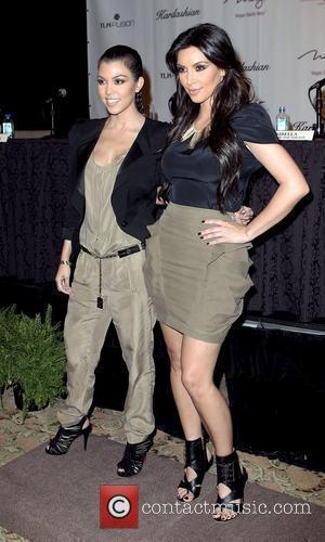 Kourtney Kardashian and Kim Kardashian  attends a press conference announcing the 'Kardashian Khaos' store opening at the Mirage Resort...
