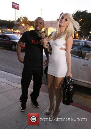 Penthouse Pet Karissa Shannon and boyfriend Sam Jones III concoct a custom shake called Kam 3 at Millions of Milkshakes...