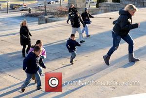 Kate Gosselin runs up the Rocky Steps at the Philadelphia Art Museum with her children being filmed for her TV...