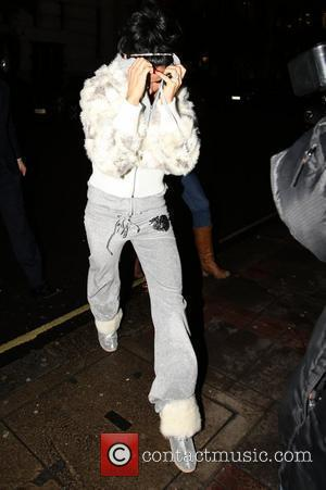 Katie Price, Aka Jordan and Arrives At The May Fair Hotel Hiding Her Face