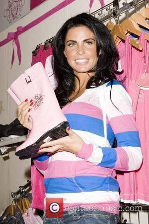 Katie Price, Aka Jordan and Poses For Photographs At Olympia For The London International Horse Show