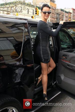 Katy Perry, Wearing A Studded Form-fitting Black Dress and Arrives At A Studio In Chinatown.