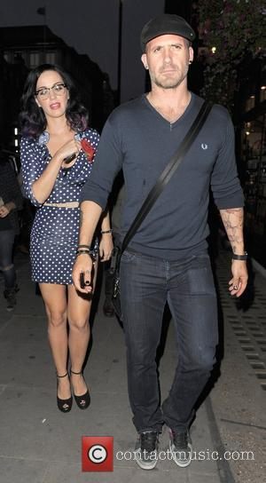 Katy Perry and A Male Companion Go Shopping In Trendy Designer Boutique Liberty Of London.
