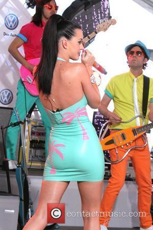 Katy Perry performs at the world premiere of the 2011 Volkswagen New Compact Sedan in Times Square New York City,...