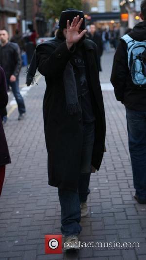 Keanu Reeves is seen shopping at Kiehl's and avoiding the paparazzi while in Covent Garden. London, England - 09.01.11