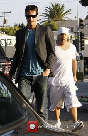 Keanu Reeves and a friend leaving Bristol Farms supermarket after purchasing groceries Los Angeles, California - 09.04.10