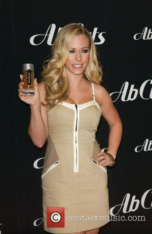 Kendra Wilkinson attends an in-store signing for Ab Cuts by Revolution Los Angeles, California - 12.01.11