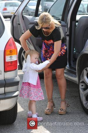 Kerry Katona takes her two youngest children, and her agent Claire Powell on a shopping trip to Curry's in Crawley,...