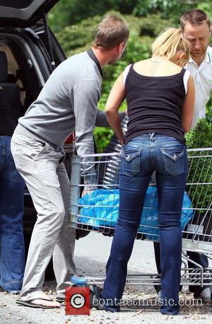 Kerry Katona and her new painter and decorator boyfriend Adam Waldron go shopping at Ikea in Purley Way with friends....