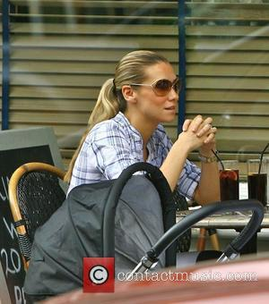Jessica Taylor at a cafe with her husband and son London, England - 20.05.10