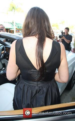 Khloe Kardashian, husband Lamar Odom leaving La Scala restaurant in Beverly Hills. She left with her back zip to her dress undone and sweat patches under her armpits