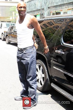 Lamar Odom waiting outside a vehicle while posing for photographs in Manhattan New York City, USA - 07.07.10