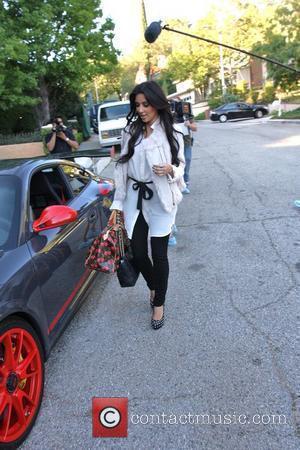 Kardashian And Bieber In The Graduate Shoot