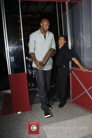 Lamar Odom leaving BOA steakhouse restaurant after celebrating Father's Day with his family Los Angeles, California, USA - 20.06.10