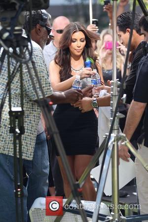 Kim Kardashian and Mario Lopez