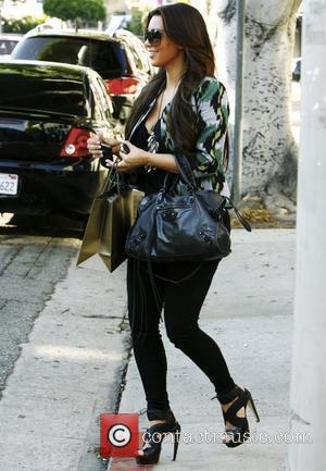 Kardashian Fighting Urge To Date Austin