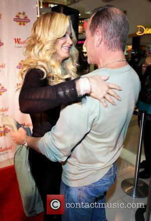 Kim Zolciak and Michael Lohan