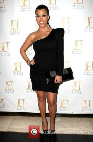 Kardashian Shrugs Off Split Rumours