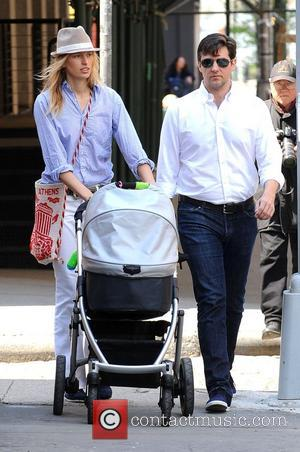 Karolina Kurkova and Archie Drury Go Out For A Walk With Their Son Tobin Drury