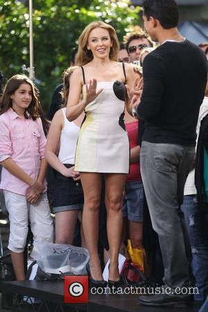 Singer Kylie Minogue wearing a two-tone dress arrives for the Extra TV show interview with Mario Lopez at The Grove...
