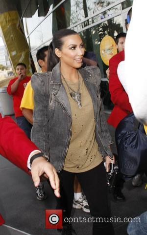 Kardashian Dismisses Andre Romance Rumours