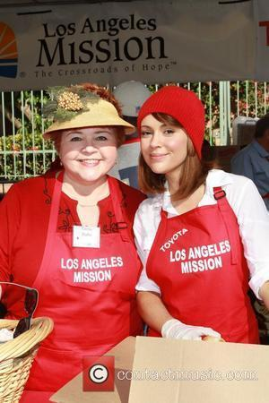 Patrika Darbo, Alyssa Milano Celebrities volunteer on Christmas Eve to serve the homeless at the Los Angeles Mission. Los Angeles,...