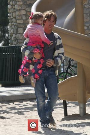Larry Birkhead playing with his daughter, Dannielynn Birkhead, at a park Los Angeles, California - 13.03.10