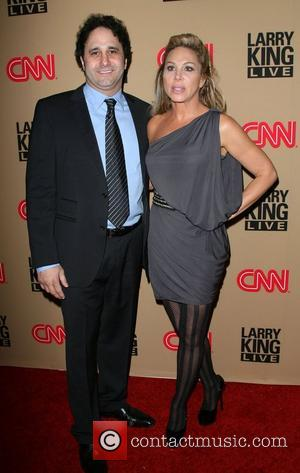 Larry King and Rachael Harris