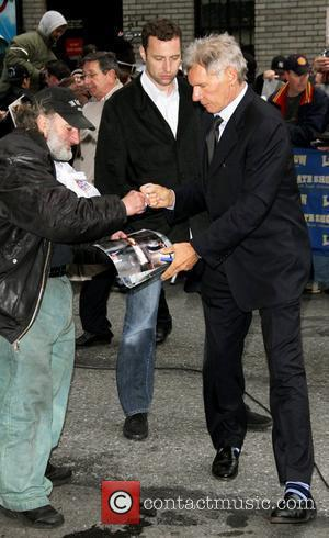 Harrison Ford gives an autograph to Radioman aka Craig Schwartz outside the Ed Sullivan theatre for The Late Show New...